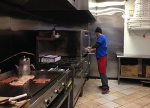 worker making pizza more than pizza new haven