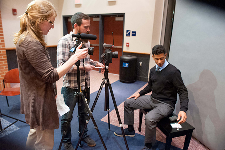 Assistant Professor Jodie Gil, left, University Assistant Jon Sackett, center, interview Jason Newton at SCSU Alumni Night. | Vern Williams Photo