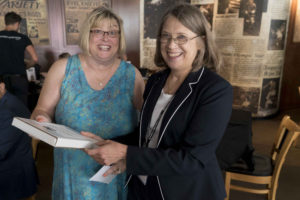Cindy Simoneau, left, receives the Teacher of the Year award from SPIG teaching chair Liz Atwood, right, during a reception in Minneapolis Aug. 5. | Vern Williams photo