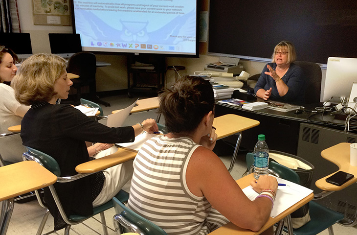 Cindy Simoneau, Journalism department chair, leads high school teachers during a workshop in June. | Vern Williams photo.