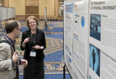 Jodie Gil, assistant professor of Journalism at SCSU, presents her research during a poster session at AEJMC in August 2016. | Vern Williams photo.